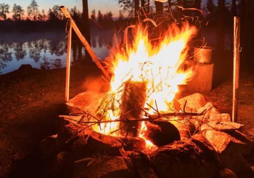 Fireplace In Camping Near Lake At Dark Night
