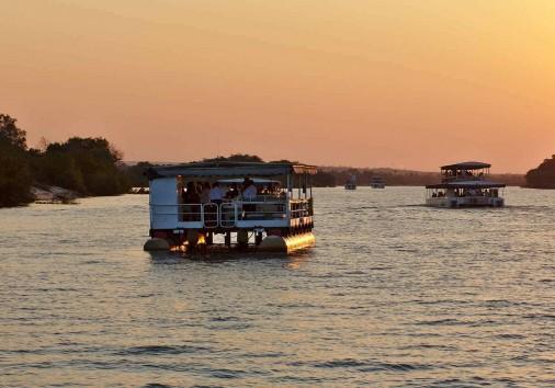 Two Safari Ships Cruising Zambezi River. Victoria Falls, Zimbabw