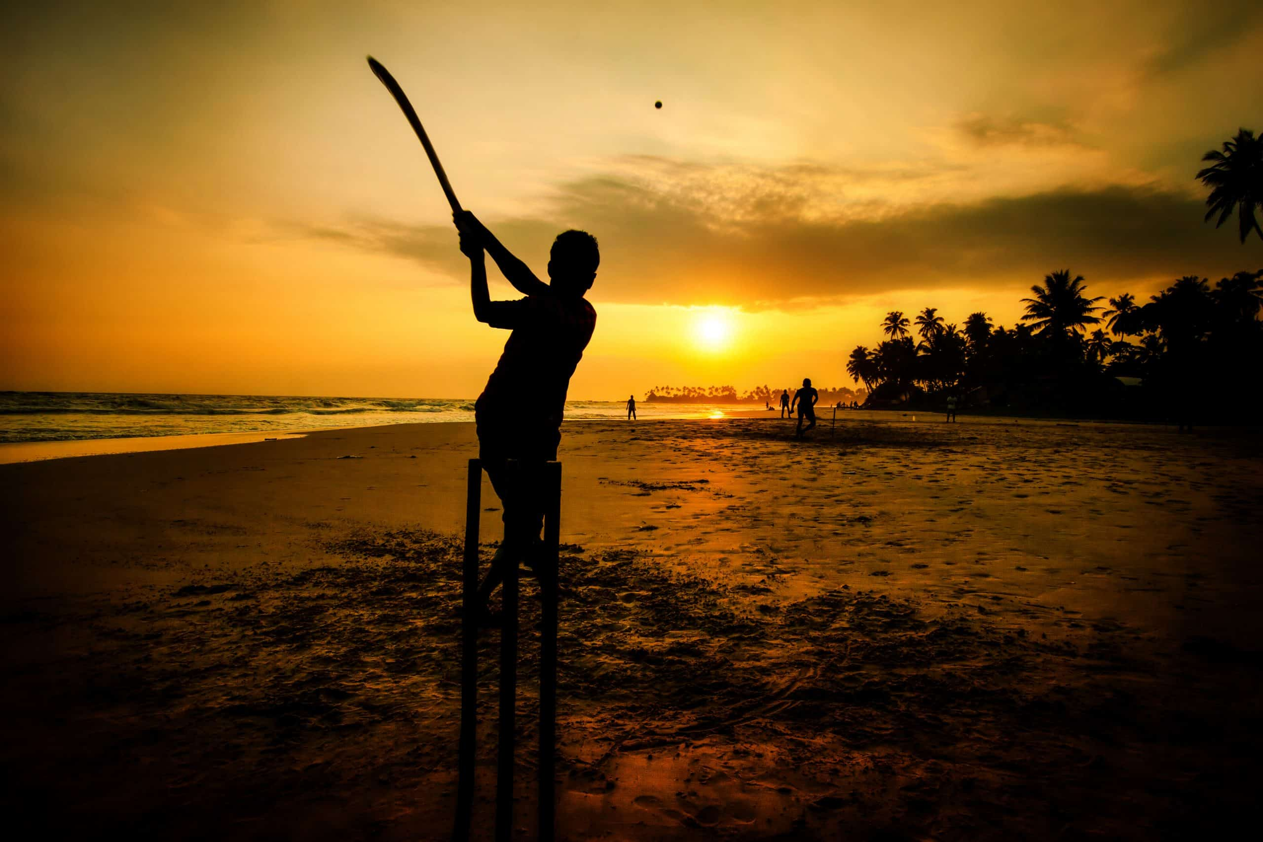 Boy Playing Cricket At Sunset On Tropical Beach National Sport In Sri Lanka Shutterstock 1117446803