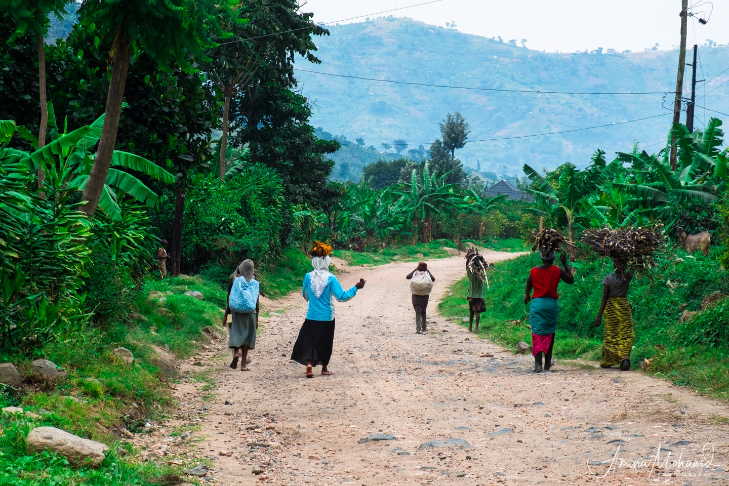 Local women carrying their wares in Rwenzori Mountains, Uganda @Amina Mohamed Photography