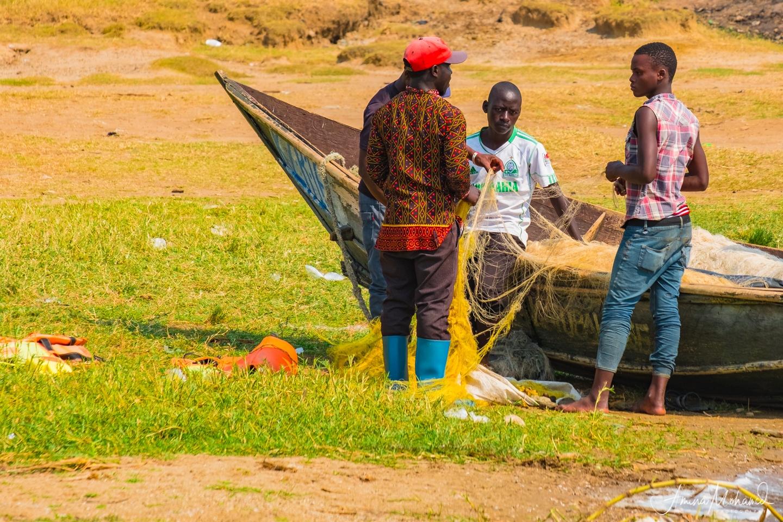 Fishermen making nets, Uganda @Amina Mohamed Photography