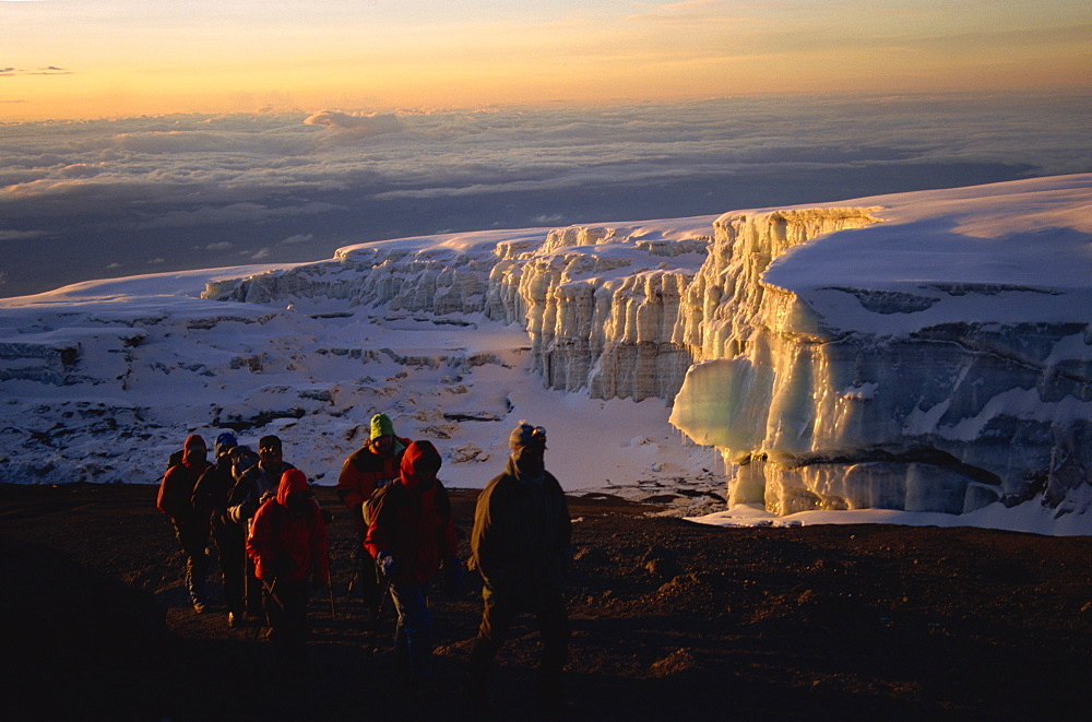 Trekkers And Glacier At Sunrise On Summit Of Kibo, 5895m, Kilimanjaro National Park, Tanzania, East Africa, Africa